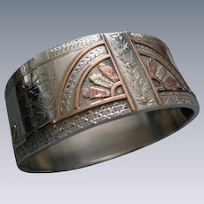 A Victorian Sterling Silver Hinged Bracelet. Circa 1885