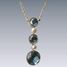 An Edwardian 15 ct Gold, Aquamarine and Seed Pearl Pendant. Circa 1905.