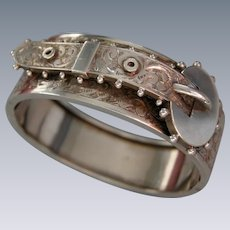 A Victorian Sterling Silver Hinged Buckle Bracelet. Circa 1885.