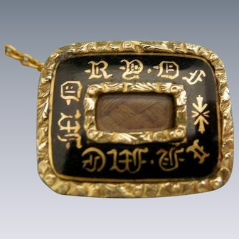 A Victorian Enamel and Cased Gold Mourning Brooch. Circa 1845