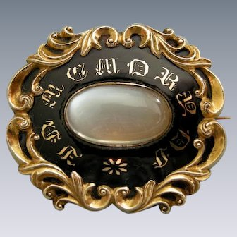 A Victorian Enamel and Gold Cased Mourning Brooch. Circa 1845