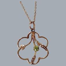 An Edwardian 9 ct Gold Peridot and Seed Pearl Pendant. Circa 1905