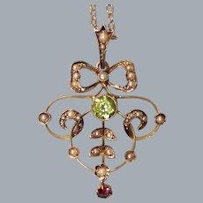 A Victorian 9 ct Gold, Peridot, Garnet & Seed Pearl Pendant. Circa 1895