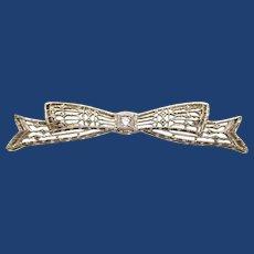 Early Art Deco 14 Karat White Gold Filigree Diamond Bow Pin