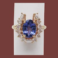14 Karat Yellow Gold Diamond and Tanzanite Horseshoe Cocktail Dinner Ring