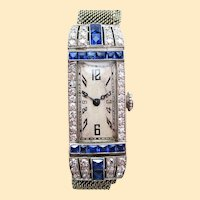 Art Deco Platinum Diamond and Calibre Sapphire Swiss Watch with 18 Karat Strap