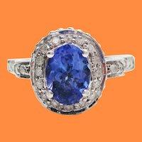 14 Karat White Gold Tanzanite and Diamond Filigree Engagement Ring