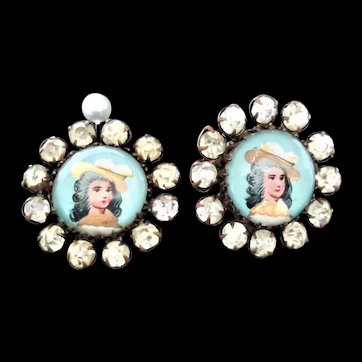 Two mid-Victorian hand-painted portrait buttons, brass, paste border