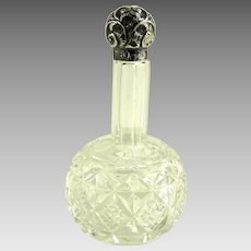 Antique English Cut Glass Perfume Bottle with Sterling Repousse Lid