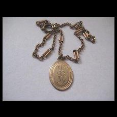 Pretty Vintage Gold Fill Pendant W.L.M. on Darling Chain