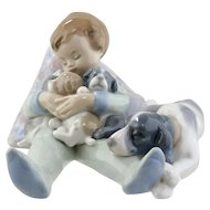 Lladro Figurine - Sleeping Child with Puppies & Mama Dog