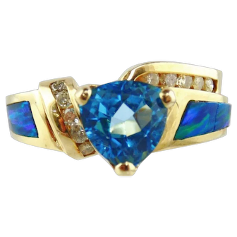 14Kt Yellow Gold Ladie's Ring with Blue Topaz, Diamonds and Opals
