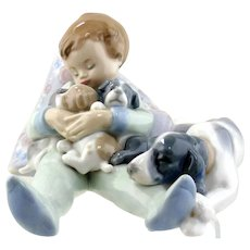 LLadro-Sleeping Child With Puppies and Mama Dog