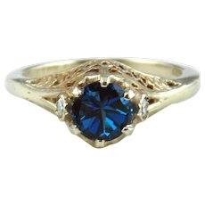 Lady's 14kt White Gold Ring with Blue Topaz & Moissanite