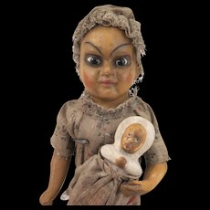 All Original Antique Papier mache Ethnic Doll with Baby