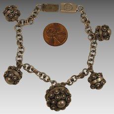 Vintage Mexican Sterling Silver Etruscan Revival Charm Bracelet