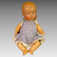 German Composition Baby Doll 10 inches plus Wardrobe