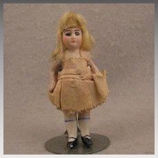 3.5 inch German Glass Eye Blond Wigged All Bisque Doll - all original