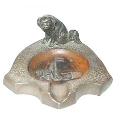 Ashtray With A Pekinese Dog On Top And An Image Of A Lady Sitting On A Musical Note