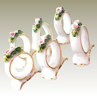 Six Porcelain Napkin Rings with Applied Roses