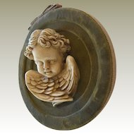 Old Cherub Wall Hanging on Velvet and Grosgrain Mount