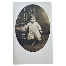 RPPC Toddler on a Victorian Stick and Ball Chair