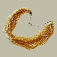 Multistrand Torsade Necklace Glittering Gold Color Glass Beads