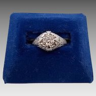 18 Karat Ring with a Round .67ct Diamond