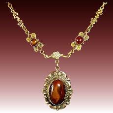 Art Deco Brass Pendant Necklace Chatoyant Brown Glass