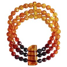 Faceted Triple Strand Amber Bead Stretch Bracelet