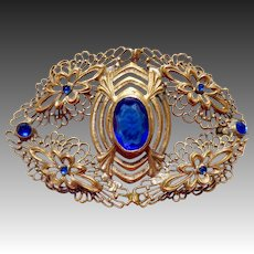 Gilt Brass Filigree Sash Ornament w Blue Glass Jewels