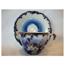 Exquisite Flow Blue German Porcelain Cup and Saucer ~ Raised Gold Outlined Flowers ~ REINHOLD SCHLEGELMILCH ~ R.S. PRUSSIA, Suhl, Prussia - ca 1894 -1910