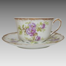 Gorgeous Limoges Cup and Saucer ~ Porcelain ~ Hand Painted with Purple Flowers ~  George Borgfeldt ( Cornet )  Limoges France 1895-1905