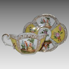 Porcelain Quatrefoil Cup and Saucer ~ Hand Painted in the Dresden Style with Yellow Panels, Flowers and Scenes 1800's