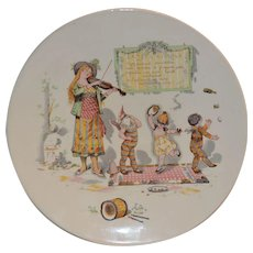 Character / Story Plate  or Plaque ~ French Faience ~ Woman Playing a Violin with Babies in Costumes Dancing~ Froment-Richard / Antoine-Albert Richard ~UTZSCHNEIDER & CO (Sarreguemines, France) – 1905-1910
