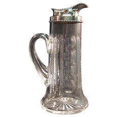 Cut Glass Pitcher with Sterling Collar