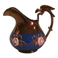 Copper Luster Pitcher with Bird Handle ca. 1845-50