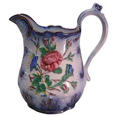Relief Molded Pitcher with Flow Blue and Luster ca. 1850