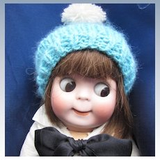 Soft Knitted Doll's Cap with Pompom