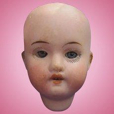 Antique Small Herm Steiner Bisque Doll Head with Eye Rocker