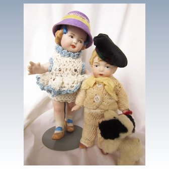 Vintage All Bisque Brother and Sister with dog