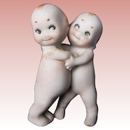Two Hugger Kewpies