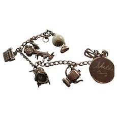 Vintage Sterling Charm Bracelet with Sterling Articulated Sterling Charms