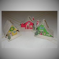 Red, Green and Yellow Tiny snow Village Christmas Ornaments.