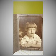 Sleepy Little Girl in Brass Photo Frame