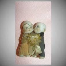 Bisque and Crepe Paper Bride and Groom Cake Topper - b40