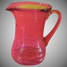 Ribbed and Swirled Hourglass Pink Glass Pitcher - b222