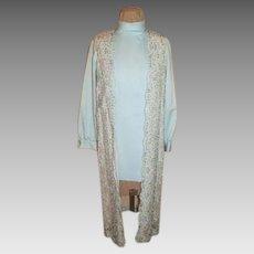 Long Beaded Vest over Mini-dress