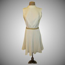 Elegance in White Knife Pleat Dress