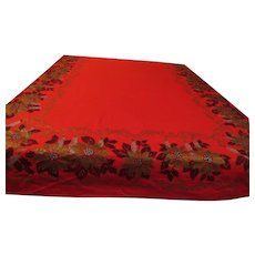 Golden Poinsettia on red Tablecloth - g